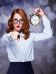 Redhead women with clock.