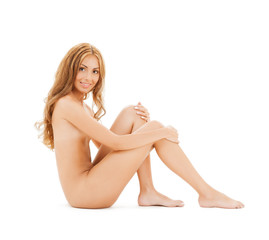 naked woman with long hair sitting on the floor