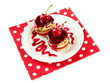 Tasty biscuit cakes with jam and berries