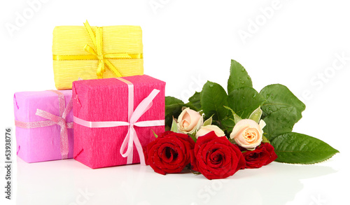 Beautiful roses and presents, isolated on white