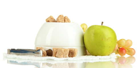 Unrefined sugar in white sugar bowl on white background