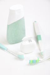 Toothbrush and dental floss isolated on white