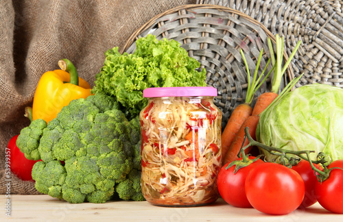 Fresh vegetables and canned on table close up