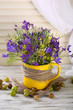 Beautiful bouquet of wildflowers in cup and berries
