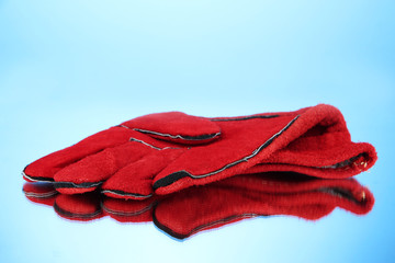 Protective gloves on blue background