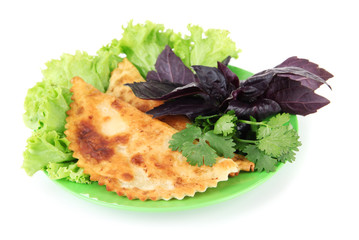 Tasty cheburek with fresh herbs on plate,isolated on white