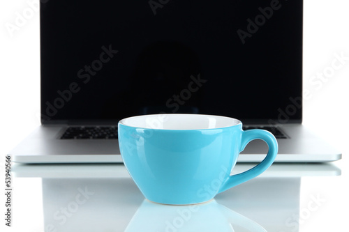 Blue cup on laptop background isolated on white