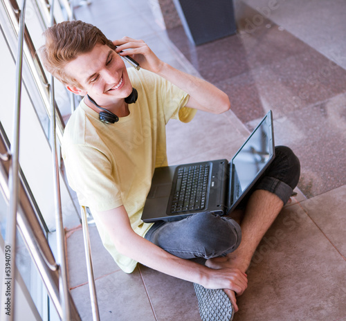 Young man talking by phone