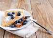 Crepes with blueberries and sugar powder