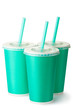 Three green cardboard cups with a straws