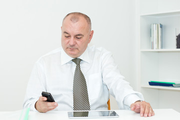 Businessman typing message