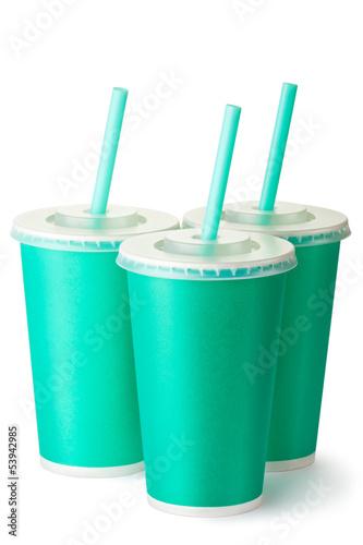 Three green cardboard cups with a straws