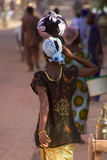Woman walking in the busy street of Mopti