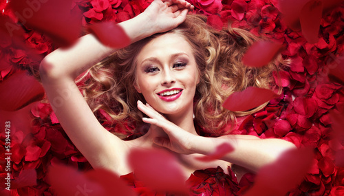 Photo of woman and downward petals