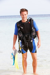 Man With Scuba Diving Equipment Enjoying Beach Holiday