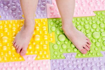 child feet on massaging mat