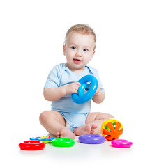 baby boy playing with color toys
