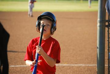 Baseball boy staring at bat