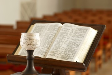 Chalice and Holy Bible opened at church