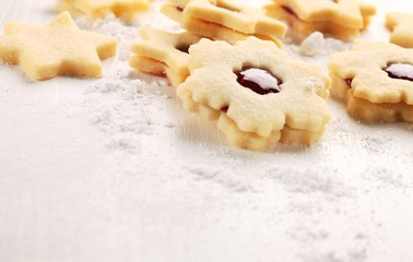 Shortbread cookies on white wooden background.