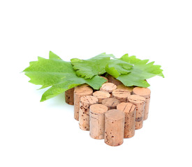 Bunch of wine corks and grape leaf