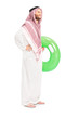 Male arab person holding a swimming ring