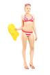 Female in bikini holding a yellow swimming float