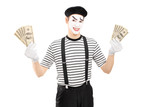 Smiling male mime artist holding US dollars