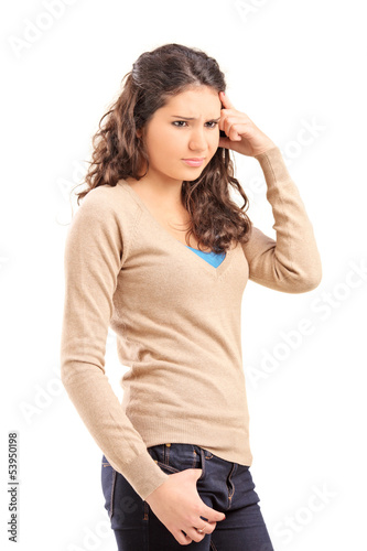 Unhappy female teenager posing