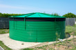 Cylindrical water storage tank.