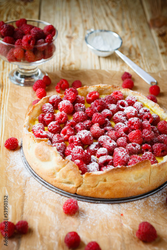 round tart with fresh raspberries