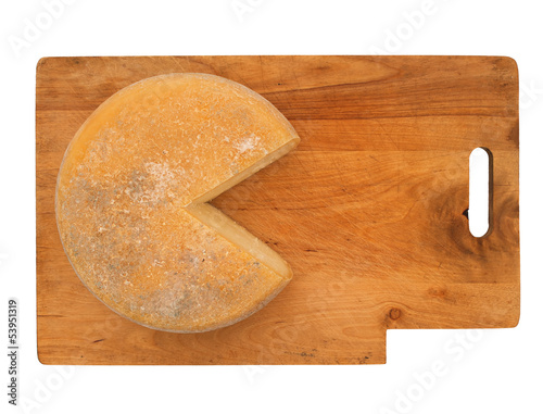 Round cheese on rustic wooden board, isolated over white
