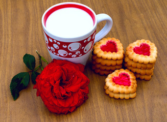 Heart-shaped cookies,  rose and a cup of milk