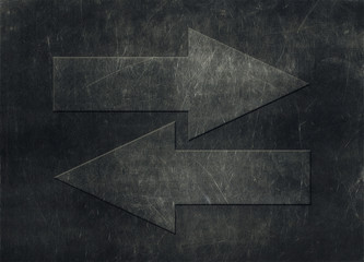 Two arrows pointing in opposite directions, grunge background