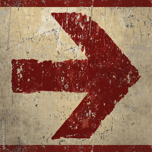 Red grunge arrow sign painted in graffiti artwork style