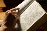 Man reading Holy Bible in the church.