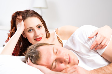 woman with her husband in bed