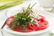 Summer salad of tomato, cucumber and radish dressed with yogurt.