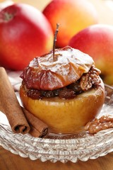 Baked stuffed apple on plate.