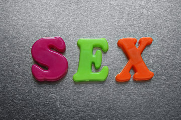 sex spelled out using colored magnets