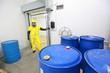 risky job - technician  checking barrels in plant