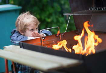 Little boy looking at the fire