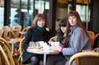 Friends in a Parisian street cafe