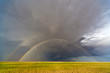 Rainbow and storm in the plains