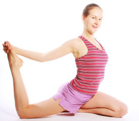 Shot of a sporty young woman doing yoga exercise.