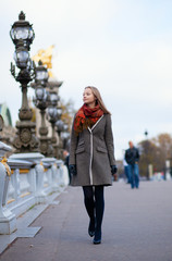 Beautiful girl walking in Paris