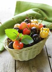 ripe berries cherries in a wicker basket