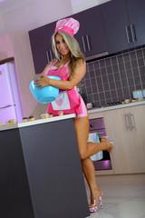 Sexy blonde baker girl in kitchen