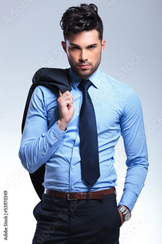 business man with jacket on shoulder
