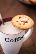 Cup of coffee with a homemade cookie
